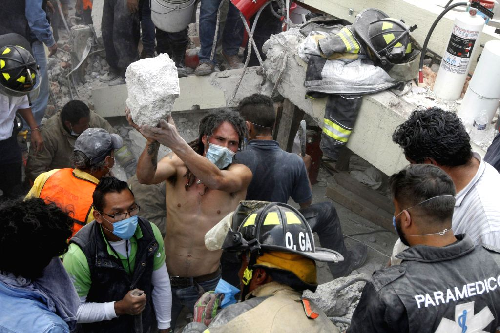 MEXICO CITY, Sept. 20, 2017 - Rescuers and volunteers work after an earthquake in Mexico City, capital of Mexico, on Sept. 19, 2017. More than 100 people were killed in a powerful 7.1-magnitude ...