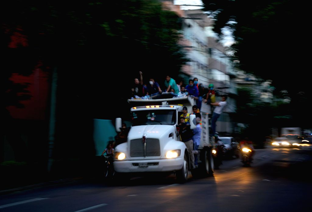 MEXICO CITY, Sept. 20, 2017 - Rescuers and volunteers arrive to the site of a collapsed building after an earthquake in Mexico City, capital of Mexico, on Sept. 19, 2017. The death toll from a ...