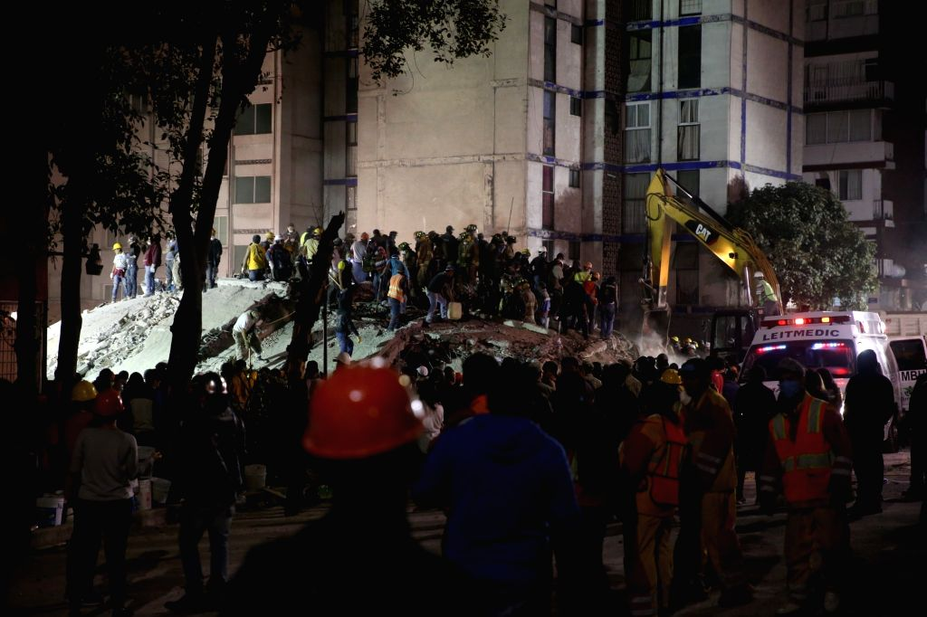MEXICO CITY, Sept. 20, 2017 - Rescuers search for survivers under the debris of a damaged building after an earthquake in Mexico City, capital of Mexico, Sept. 20, 2017. At least 217 people have been ...