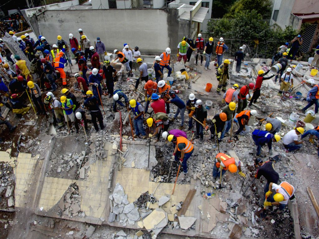 MEXICO CITY, Sept. 21, 2017 - Photo taken with a drone shows rescuers and volunteers searching for survivors after an earthquake in Mexico City, capital of Mexico, on Sept. 20, 2017. Elements from ...
