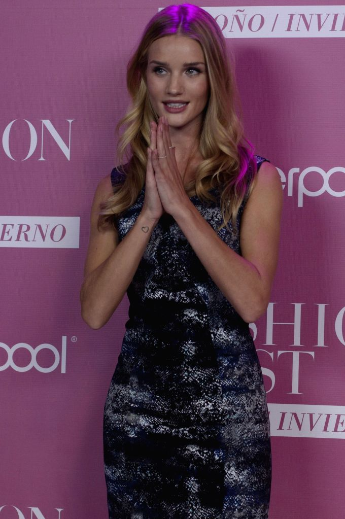 British model Rosie Huntington poses during a press conference ahead of the Fashion Fest Autumn-Winter 2014, in the Hipodromo de las Americas, in Mexico City, .. - Rosie Huntington