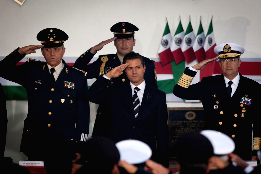 Mexican President, Enrique Pena Nieto (C) participates in the ceremony of the 167th anniversary of the Molino del Rey Battle and memorial of the burial of the ..