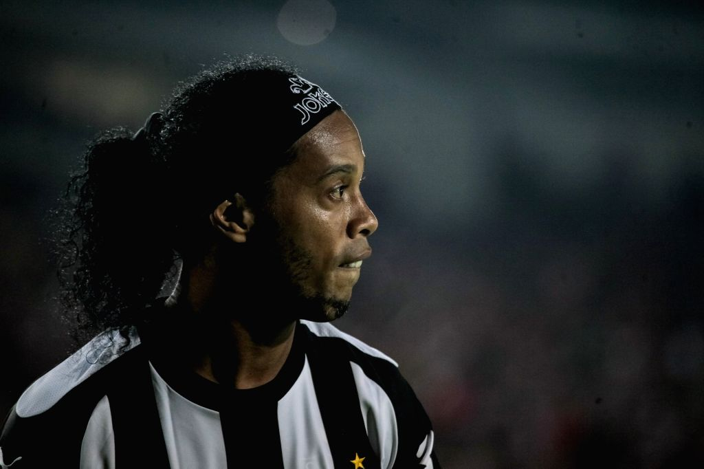 File imgae taken on April 4, 2014 shows Brazilian soccer player Ronaldinho reacting during a match of Libertadores Cup between Brazil's Atletico Mineiro and
