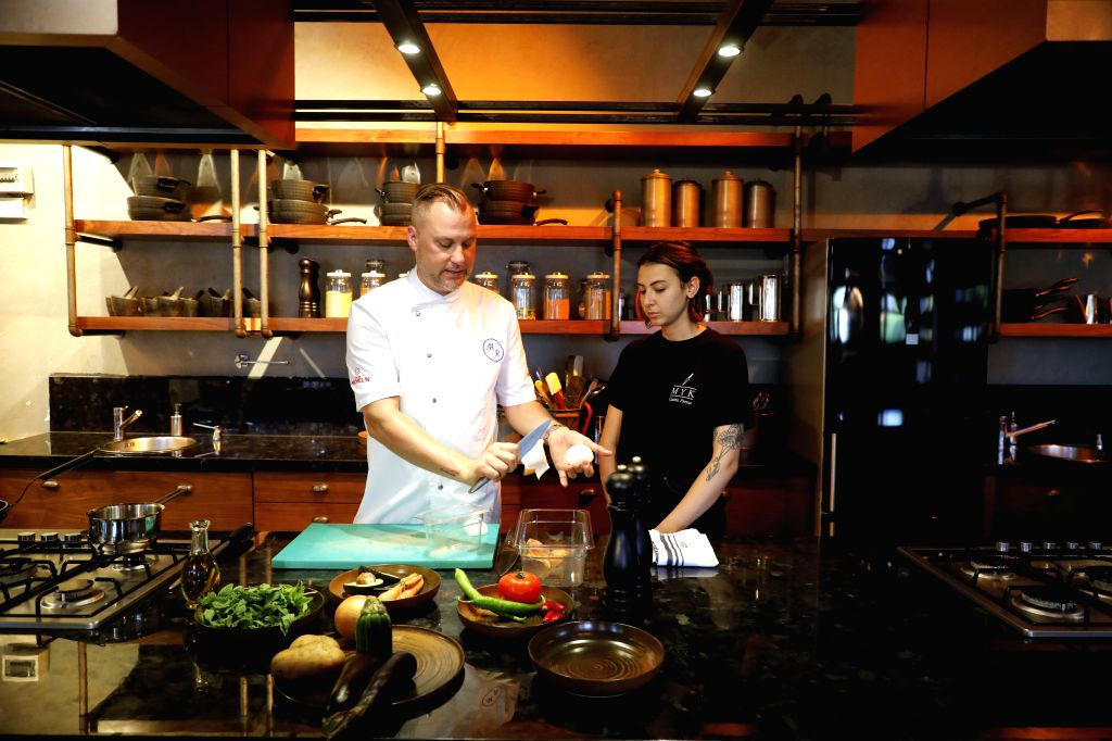 Michelin-starred German chef Michael Riemenschneider (L) instructs a young chef at his restaurant in Istanbul, Turkey, Aug. 12, 2020. After spending almost four ...