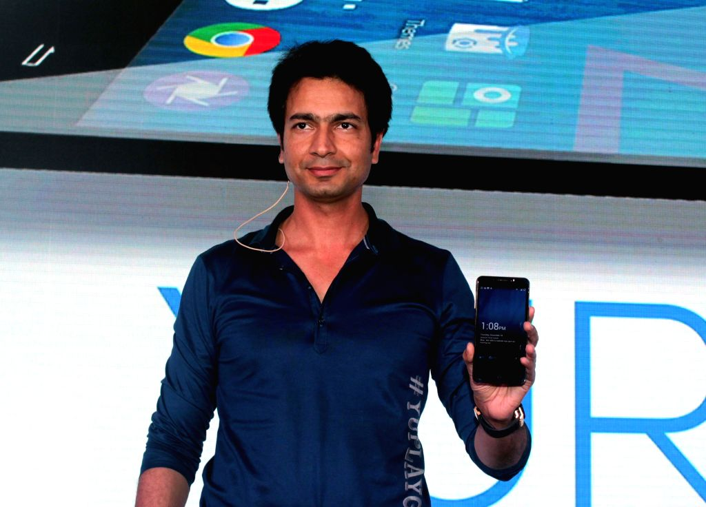 Micromax co-founder Rahul Sharma at the launch of CyangennMod powered phone Yu in New Delhi, on Dec 18, 2014. - Rahul Sharma