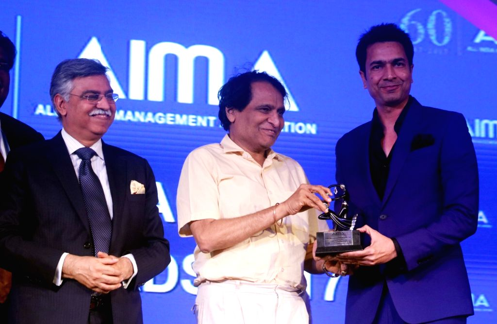 Micromax Informatics Rahul Sharma receives Transformational Business er of the Year award from Union Railway Minister Suresh Prabhu at the AIMA Awards ceremony in New Delhi, on April ... - Suresh Prabhu