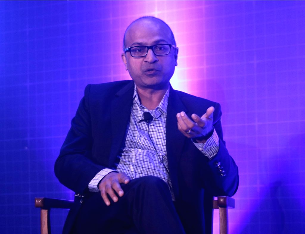 Microsoft India MD Anil Bhansali addresses during a programme on 'Unlocking the Economic Impact of Digital Transformation in India', in New Delhi on April 11, 2018.