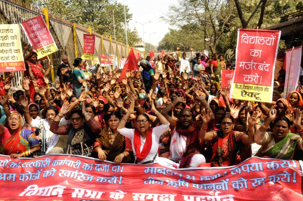 Mid-Day Meal cooks protest against the state government, demanding an increase in honorarium and equal pay for equal work, in Patna, Friday, February 26, 2021