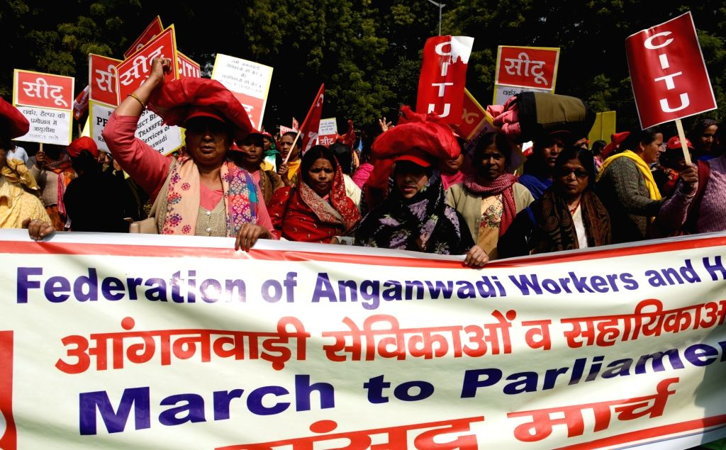 Midday meal workers stage a demonstration to press for their demands in New Delhi, on Feb 25, 2019.