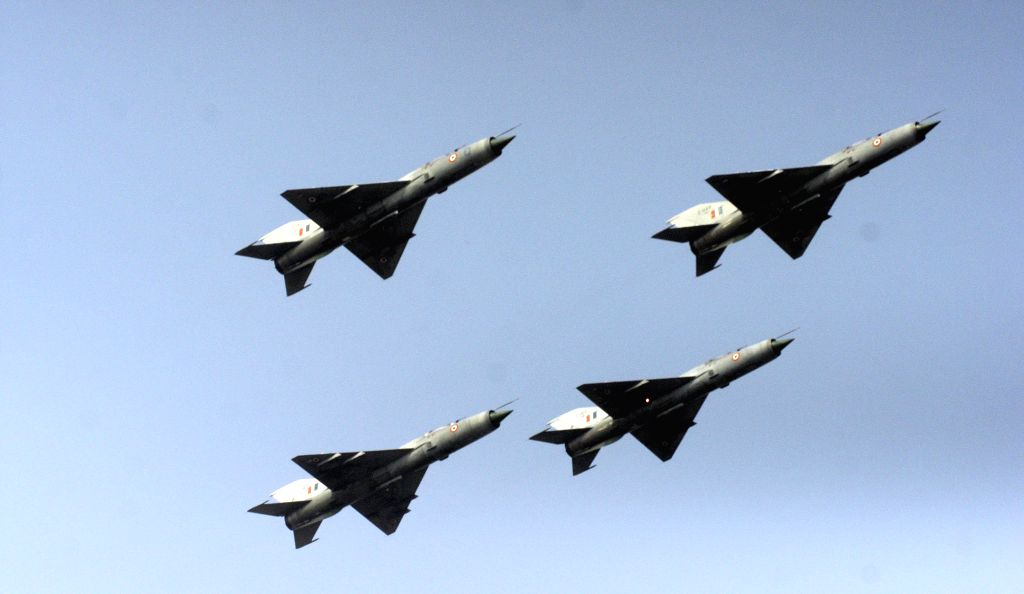 MiG 21 FL (Type - 77) Supersonic Fighter plane flies for the last time during passing out ceremony at Kalaikunda Air Force Station in Midnapore of West Bengal on Dec.11, 2013. (Photo: IANS)