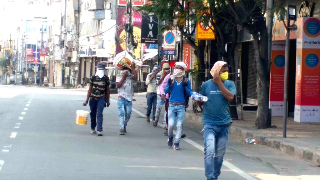Migrant laborers head back home on foot on Day 5 of the 21-day countrywide lockdown imposed to contain the spread of novel coronavirus, in Hyderabad on March 29, 2020.