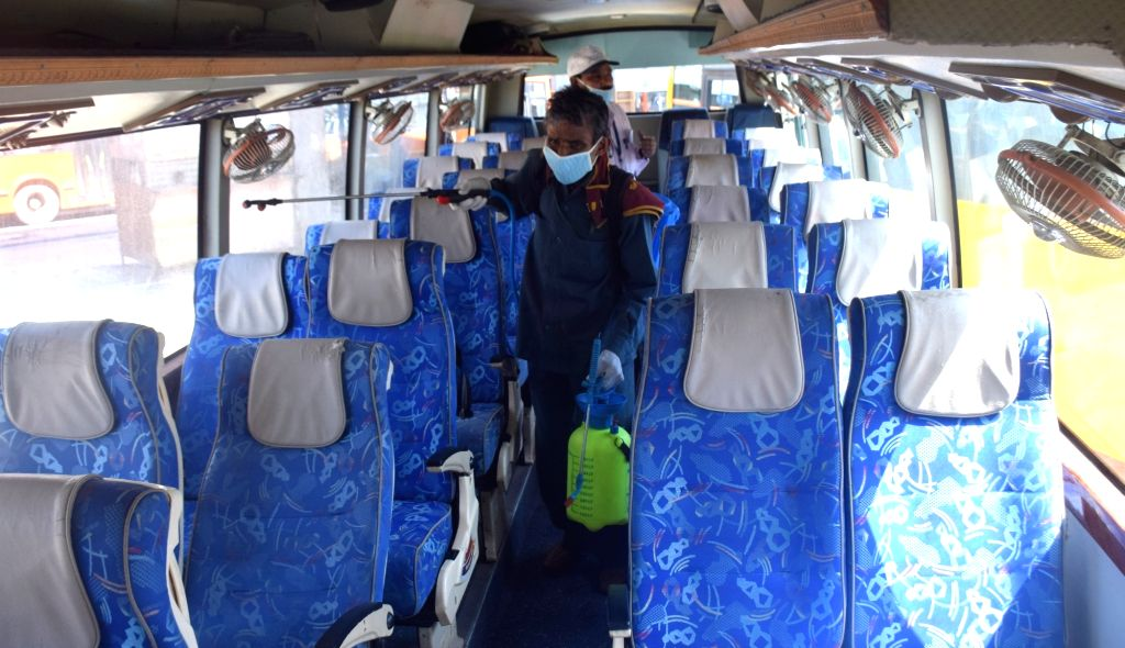 Migrant laborers heading back home, board a bus from Anand Vihar bus terminal close to Delhi's border with Ghaziabad on Day 5 of the 21-day countrywide lockdown imposed to contain the ...