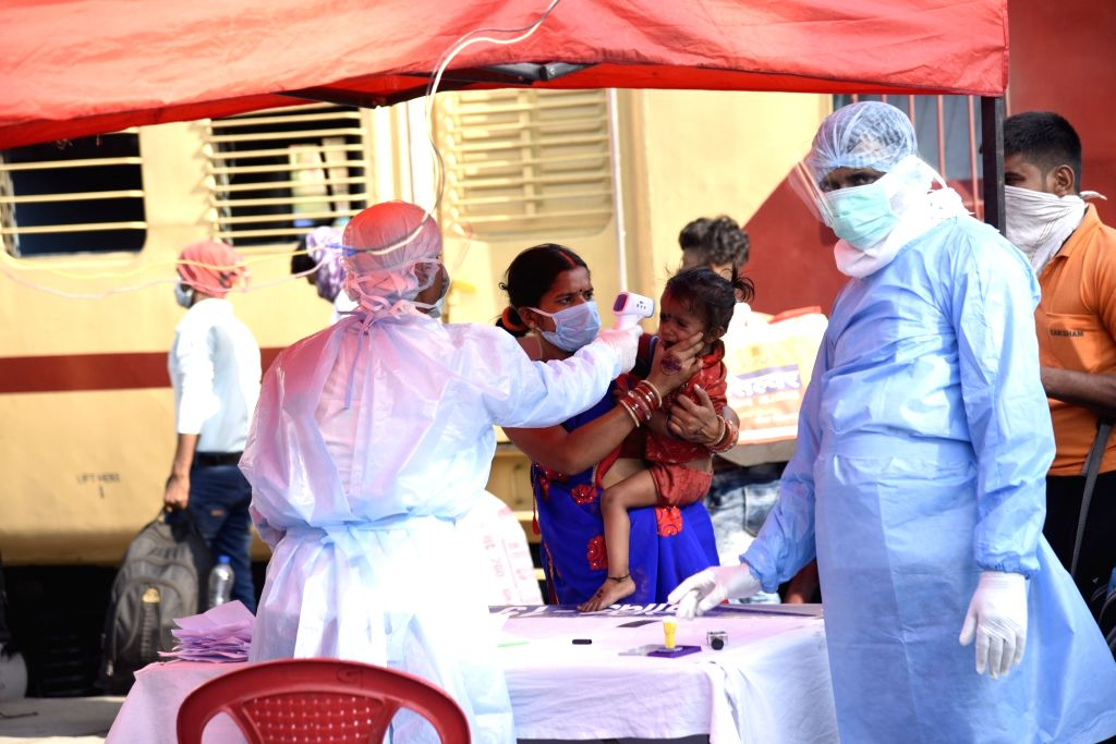 Migrant workers from Bihar who were stranded in Gujarat's Godhra due to the ongoing nationwide lockdown imposed to mitigate the spread of coronavirus, arrive at Danapur railway station on a ...