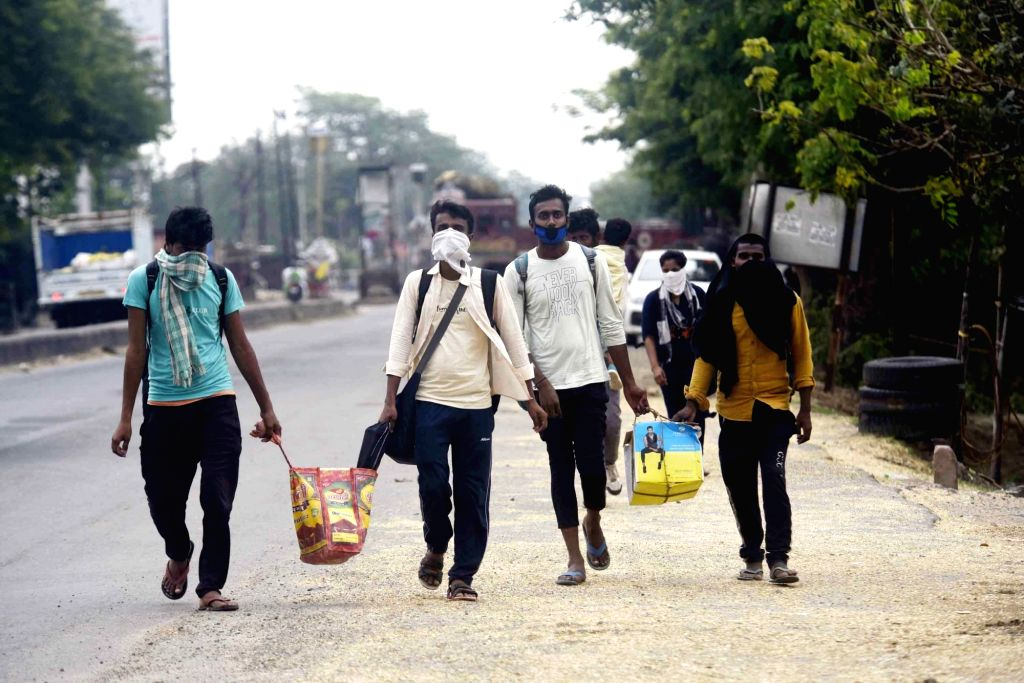 Migrant workers from Jharkhand who were stranded in Bihar due to the ongoing nationwide lockdown imposed to mitigate the spread of coronavirus, return home from Patna on May 7, 2o2o.