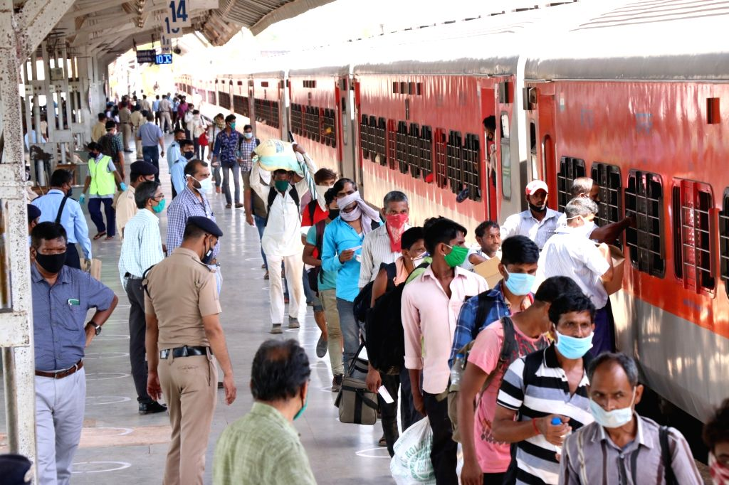 Migrant workers from Madhya Pradesh who were stranded in Goa due to the ongoing nationwide lockdown imposed to mitigate the spread of coronavirus, arrive at Thivim Railway Station to board a ...