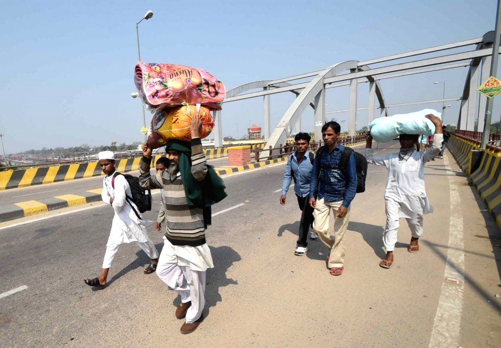 Migrant workers from Mumbai and Pune arrive in Patna after COVID-19 pandemic brought daily businesses at a halt, during nationwide shutdown - Janata Curfew - imposed to contain the spraed of ...