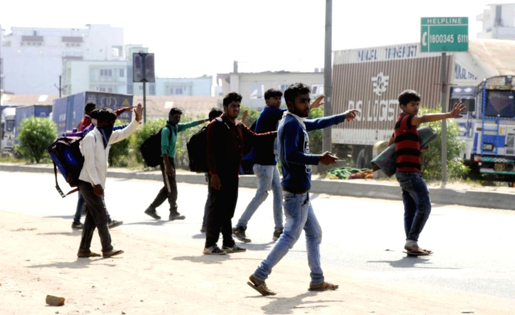Migrant workers heading back home ask for lift on Day 5 of the 21-day countrywide lockdown imposed to contain the spread of novel coronavirus, in Patna on March 29, 2020.