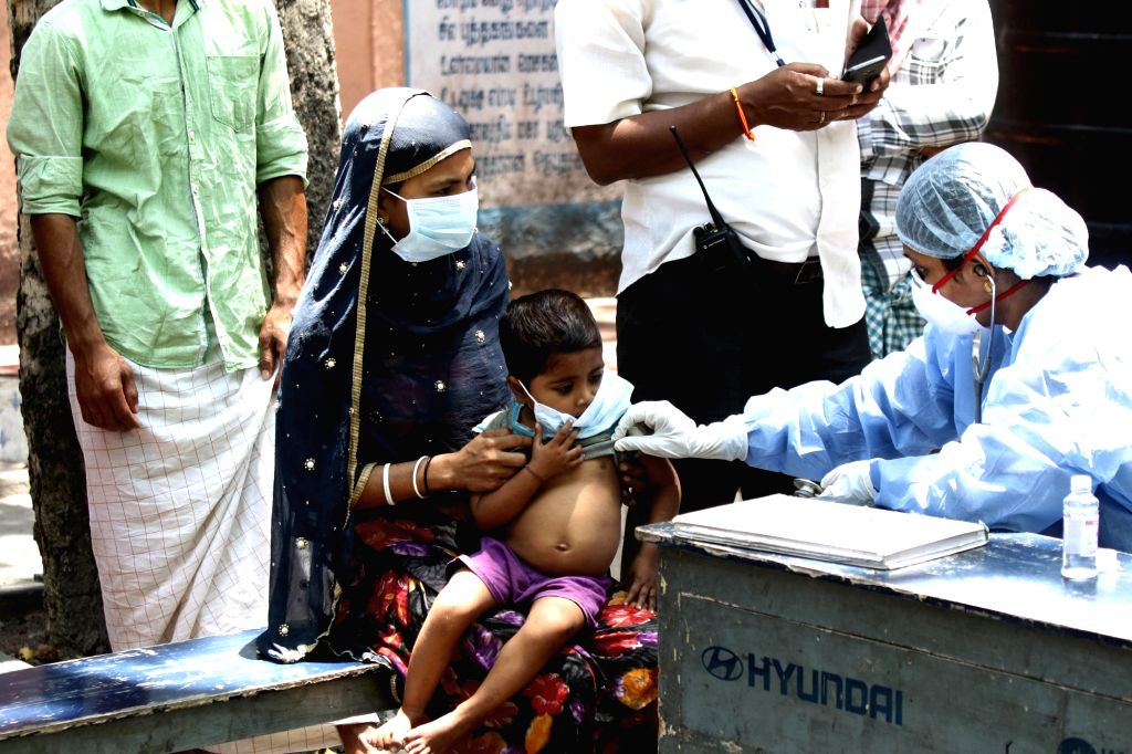 Migrant workers unable to reach their homes due to nationwide lockdown, being screened for COVID-19 by a team of doctors at a shelter home in Chennai on March 26, 2020.