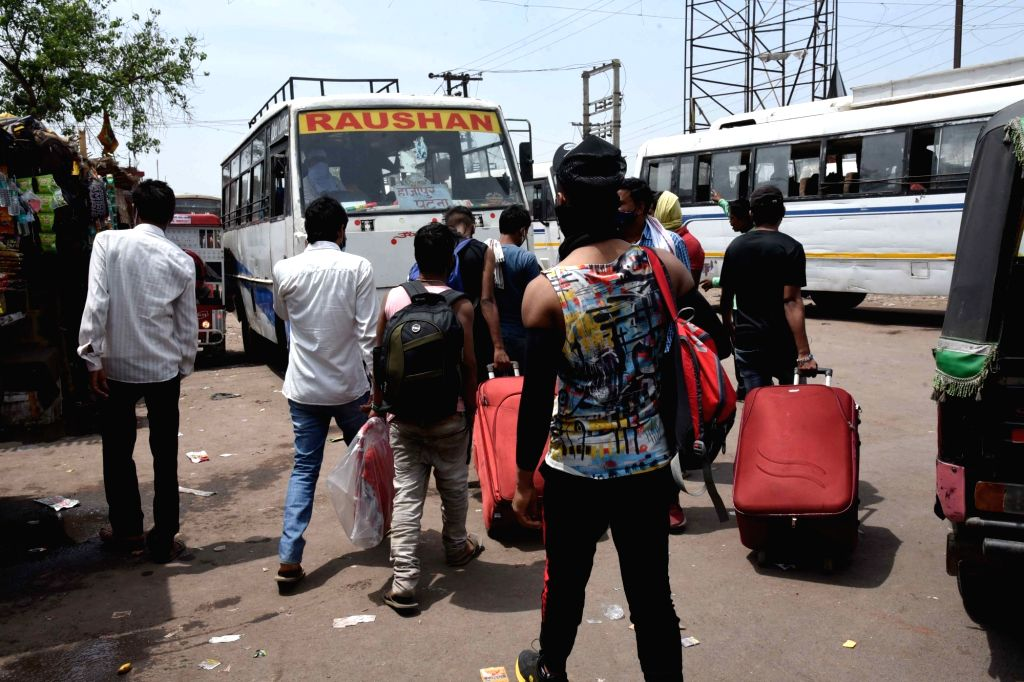 Migrants arrive from various state to reach their native palaces , amid rise in Covid-19 cases across the country, in Patna, Friday, April 23, 2021