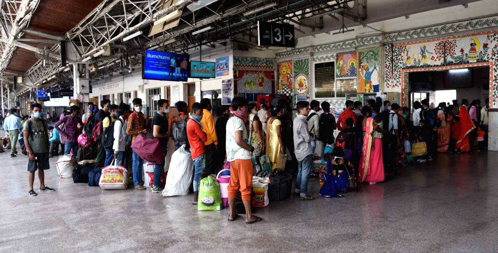 Migrants arriving from Maharashtra by a special train wait in a queue for Covid-19 test at Patna railway station, amid the rise in Covid-19 cases across the country, in Patna on Sunday, 18th ...