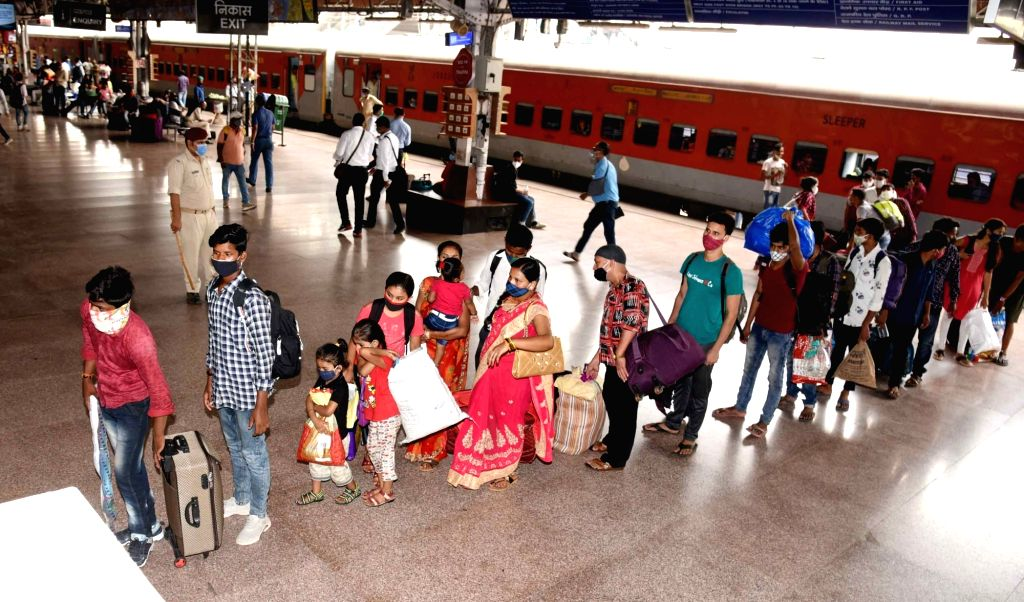 Migrants arriving from New Delhi by a special train, amid the rise in Covid-19 cases across the country, in Patna, Wednesday, April 21, 2021.