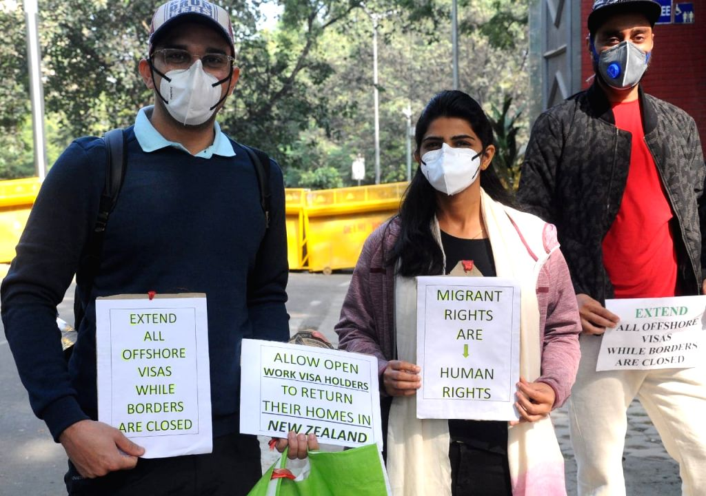 Migrants from New Zealand staged a silent protest against New Zealand government, demanding to bring back to them, their work VISA extended, they are stuck in India due to Covid 19 Pandemic, in new ...