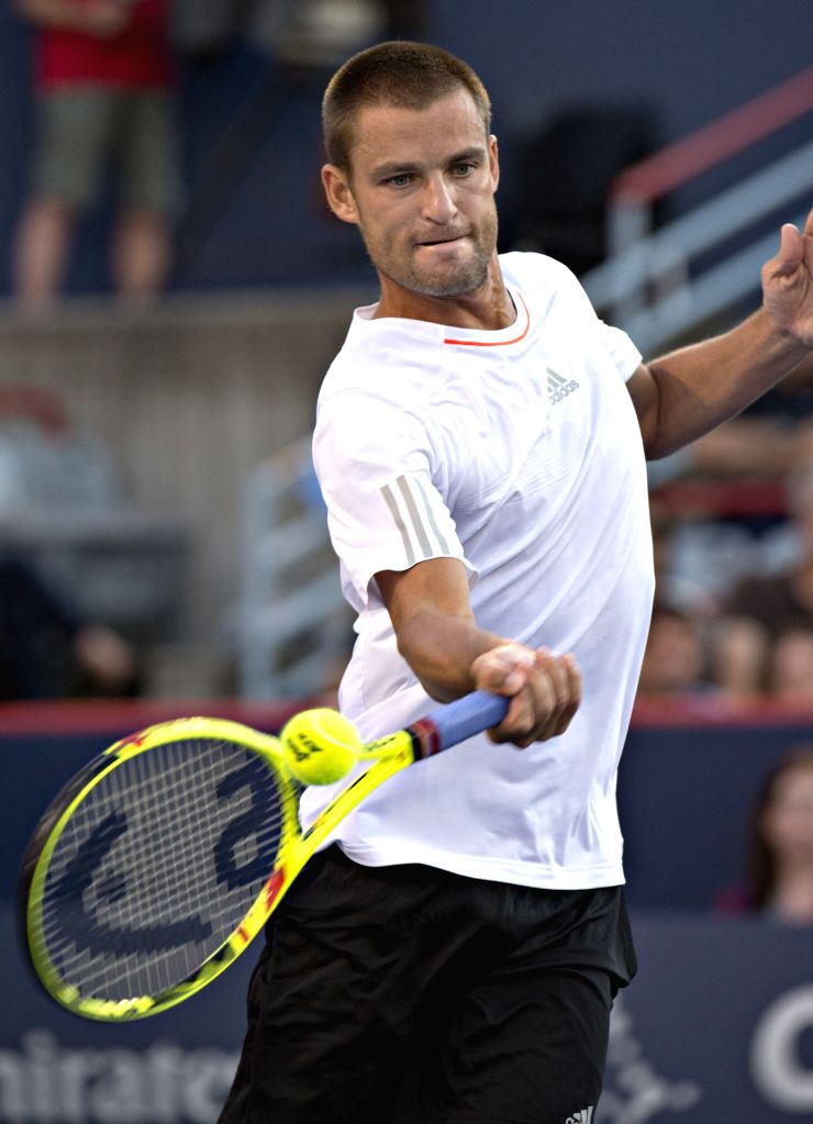 Mikhail Youzhny of Russia hits a return to Rafael Nadal of Spain at the Rogers Cup in Montreal, Canada, on Aug. 13, 2015. Youzhny lost the match 0-2. ...