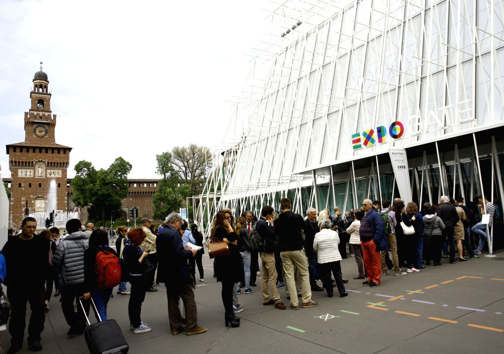 """People queue for tickets to the Milan Expo in Milan, Italy, on April 29, 2015. The Milan Expo with the theme """"Feeding the Planet, Energy for Life"""" will ..."""