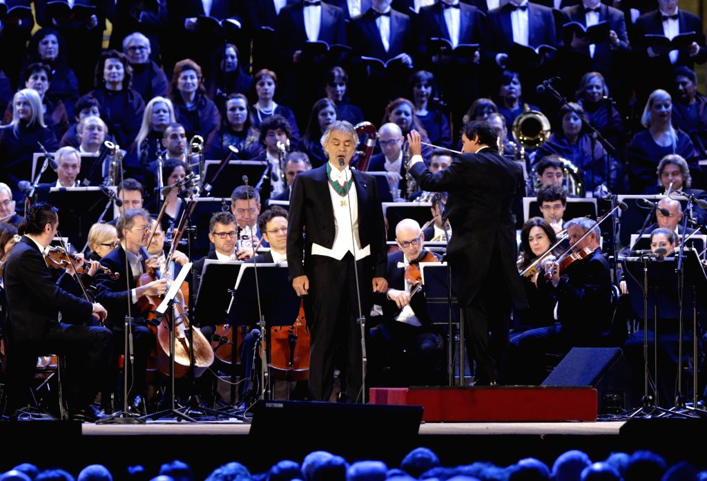 Italian tenor Andrea Bocelli(C) performs during the opening ceremony of 2015 Milan Expo, in Milan, Italy, April 30, 2015. The Milan Expo with the theme 'Feeding the ...