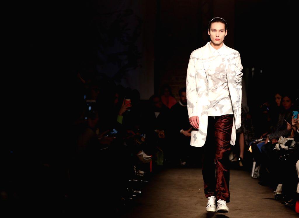 MILAN, Feb. 24, 2019 - A model presents a creation of Atsushi Nakashima during Milan Fashion Week Autumn/Winter 2019/2020 in Milan, Italy, on Feb. 24, 2019.