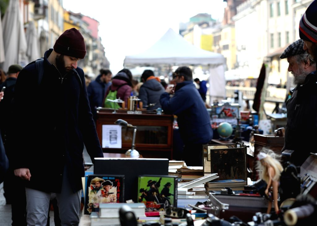 MILAN, Feb. 25, 2019 - A man visits the antique market along the Naviglio Grande in Milan, Italy, Feb. 24, 2019. The antique market, organized by the Association of Naviglio Grande, takes place along ...