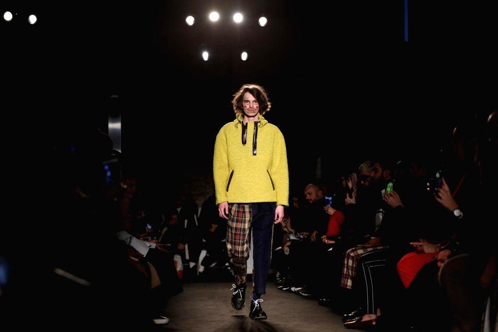MILAN, Feb. 25, 2019 - A model presents a creation of Alexandra Moura during Milan Fashion Week Autumn/Winter 2019/2020 in Milan, Italy, Feb. 25, 2019.
