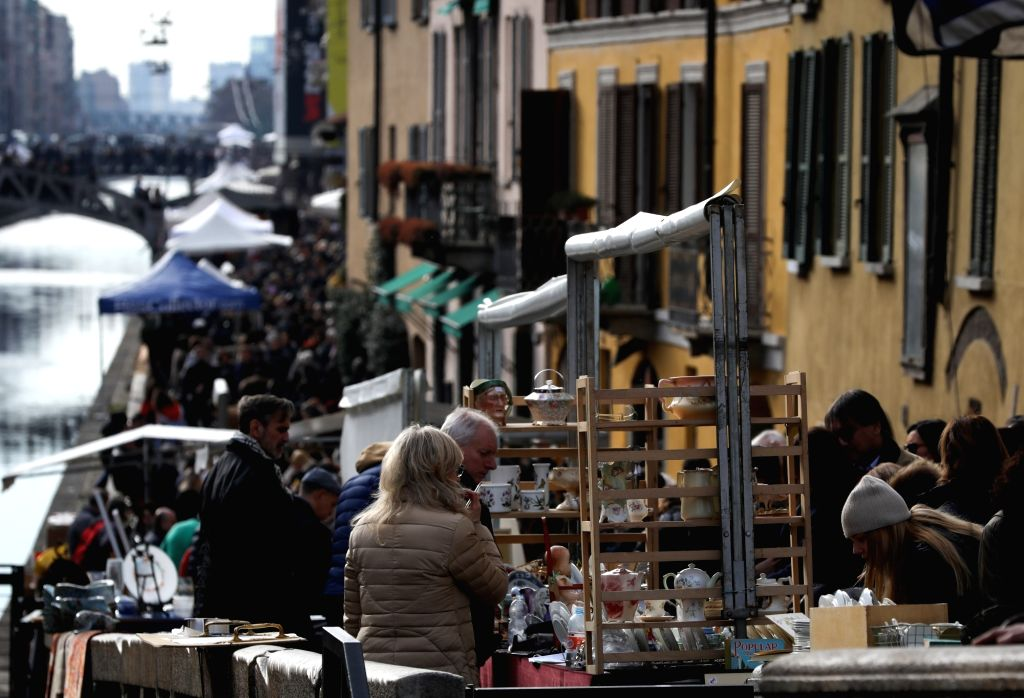 MILAN, Feb. 25, 2019 - People visit the antique market along the Naviglio Grande in Milan, Italy, Feb. 24, 2019. The antique market, organized by the Association of Naviglio Grande, takes place along ...