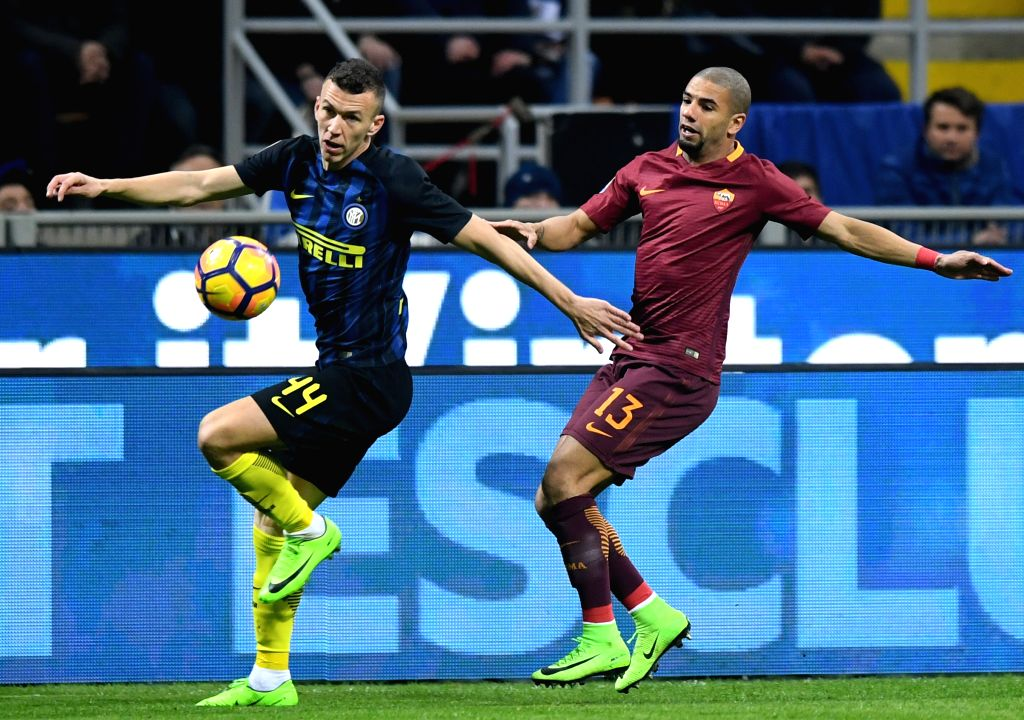 MILAN, Feb. 27, 2017 - Inter Milan's Ivan Perisic (L) competes with Roma's Bruno Peres during a Serie A soccer match between Roma and Inter Milan, in Milan, Italy, Feb. 26, 2017.Roma won by 3-1.