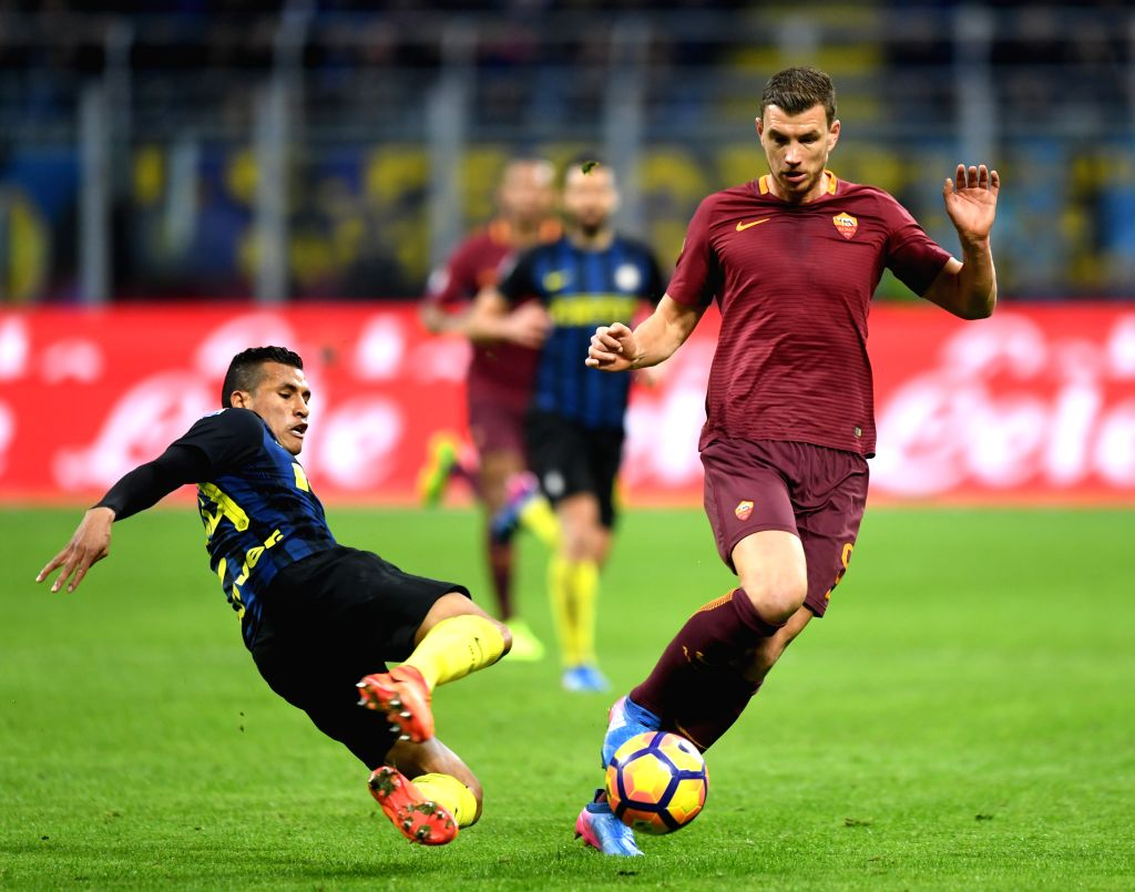 MILAN, Feb. 27, 2017 - Inter Milan's Jeison Murillo competes with Roma's Edin Dzeko during a Serie A soccer match between Roma and Inter Milan, in Milan, Italy, Feb. 26, 2017. Roma won by 3-1.