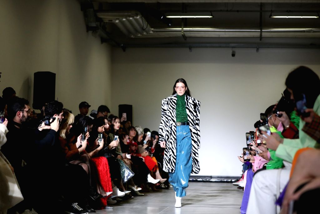 MILAN (ITALY), Feb. 20, 2019 A model presents a creation of ANNAKIKI during Milan Fashion Week Autumn/Winter 2019/2020 in Milan, Italy, on Feb. 20, 2019.