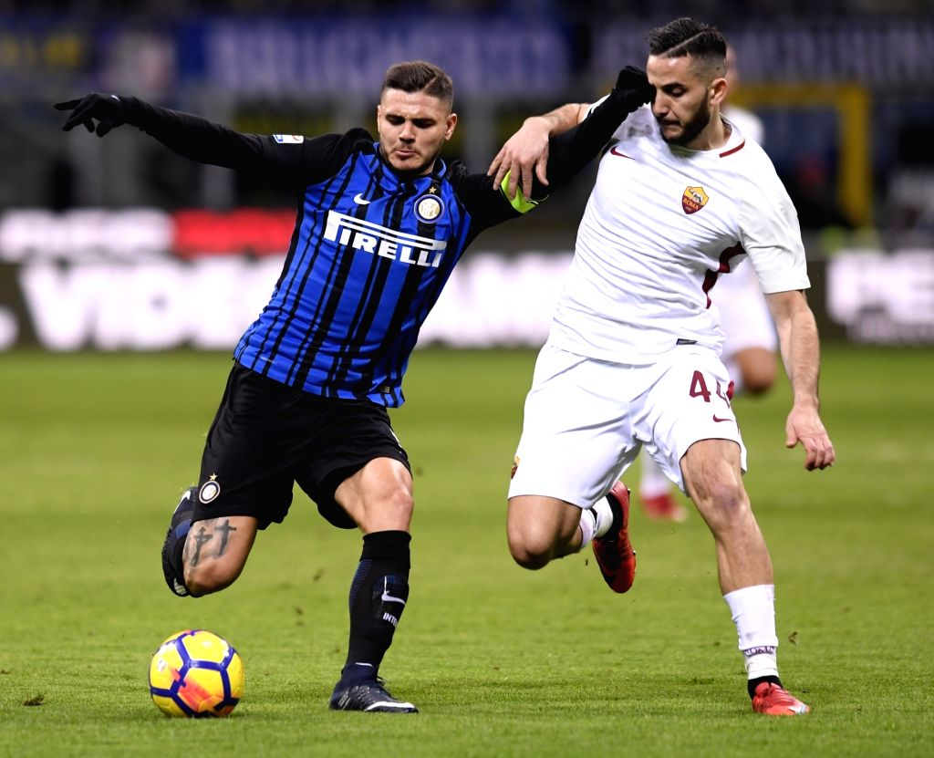 MILAN, Jan. 22, 2018 - Inter Milan's Mauro Icardi (L) competes with Roma's Kostas Manolas during a Serie A soccer match between Inter Milan and Roma in Milan, Italy, Jan. 21, 2018. The game ends with ...