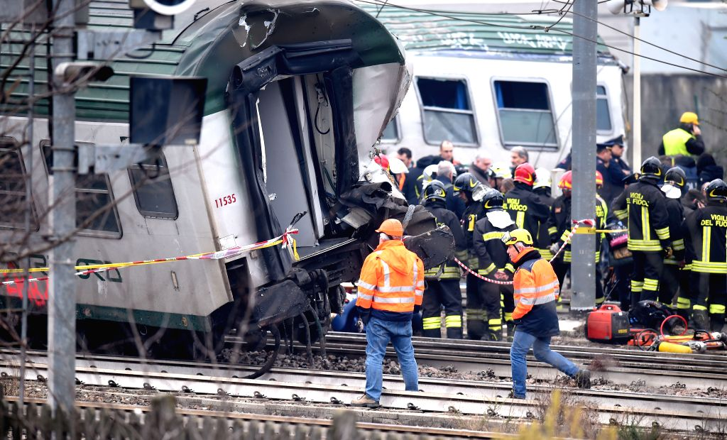 MILAN, Jan. 25, 2018 - Rescuers and authorities work by the wagons of a derailed train on the outskirts of Milan, Italy, Jan. 25, 2018. At least two people were killed and 10 others seriously injured ...