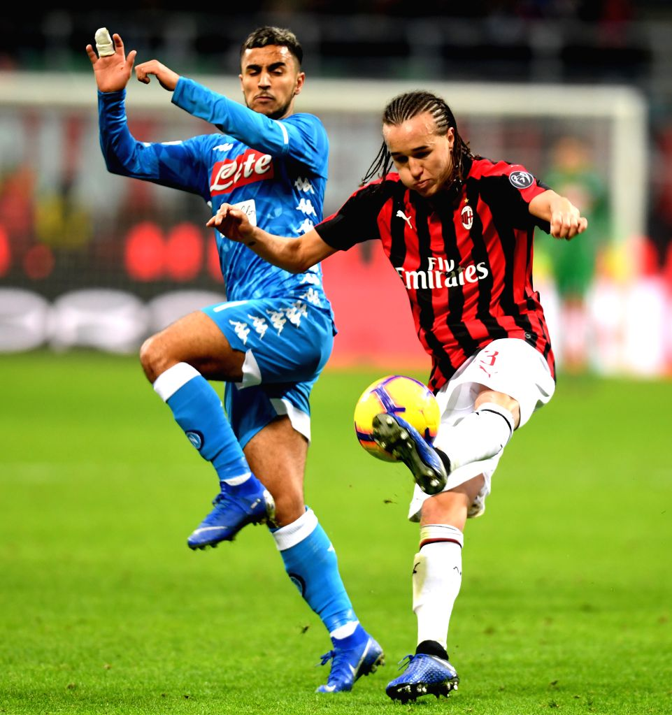 MILAN, Jan. 30, 2019 - AC Milan's Diego Laxalt (R) vies with Napoli's Adam Ounas during the Italian Cup quarterfinal match between AC Milan and Napoli in Milan, Italy, Jan. 29, 2019.