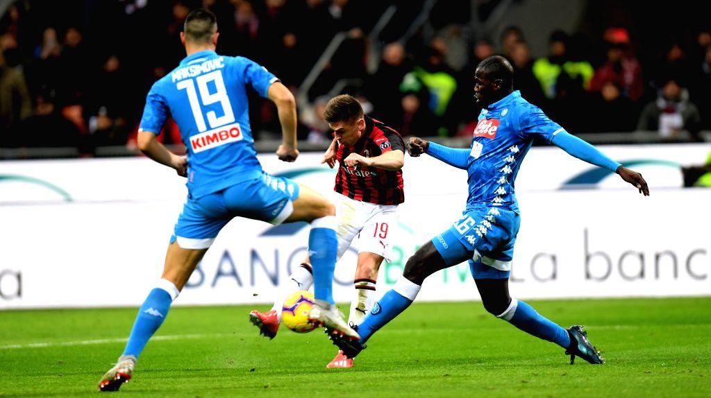 MILAN, Jan. 30, 2019 - AC Milan's Krzysztof Piatek (C) scores his second goal during the Italian Cup quarterfinal match between AC Milan and Napoli in Milan, Italy, Jan. 29, 2019.