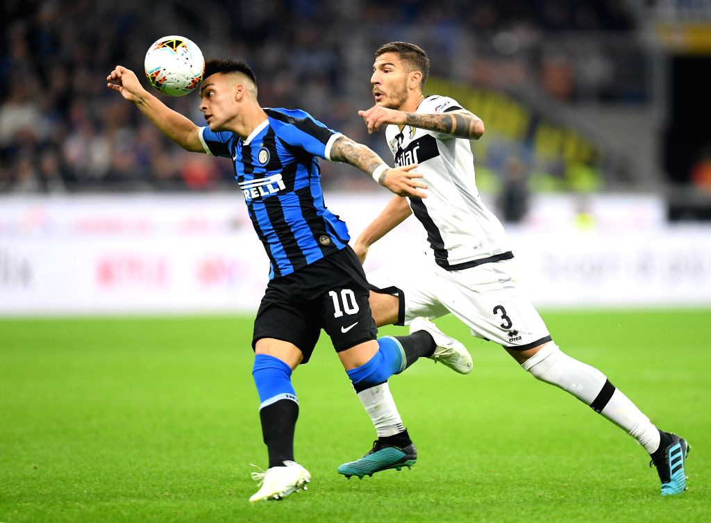 MILAN, Oct. 27, 2019 - FC Inter's Lautaro Martinez (L) vies with Parma's Kastriot Dermaku during a Serie A soccer match between FC Inter and Parma in Milan, Italy, Oct. 26, 2019.