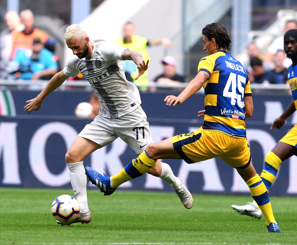 MILAN, Sept. 16, 2018 - FC Inter's Marcelo Brozovic (L) vies with Parma's Roberto Inglese during a Serie A soccer match between FC Inter and Parma in Milan, Italy, Sept. 15, 2018. FC Inter lost 0-1.
