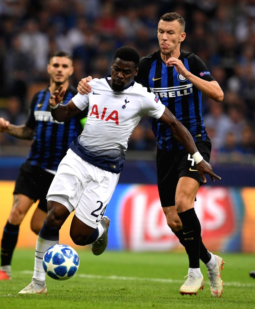 MILAN, Sept. 19, 2018 - Inter Milan's Ivan Perisic (1st R) vies with Tottenham's Serge Aurier (C) during a UEFA Champions League group B match between FC Inter and Tottenham Hotspur, in Milan, Italy, ...