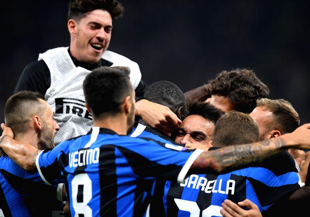 MILAN, Sept. 22, 2019 - Inter Milan's Romelu Lukaku (C) celebrates his goal with his teammates during a Serie A soccer match between AC Milan and Inter Milan in Milan, Italy, Sept. 21, 2019.