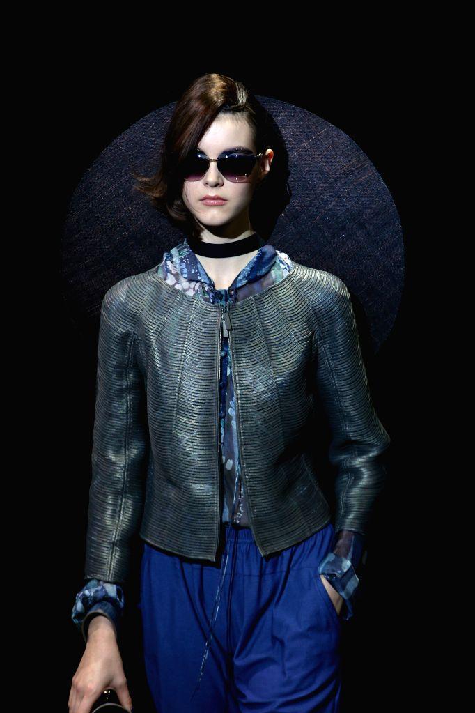 MILAN, Sept. 23, 2016 - A model presents a creation at Giorgio Armani fashion show during Milan Fashion Week Spring/Summer 2017 in Milan, Italy, Sept. 23, 2016.