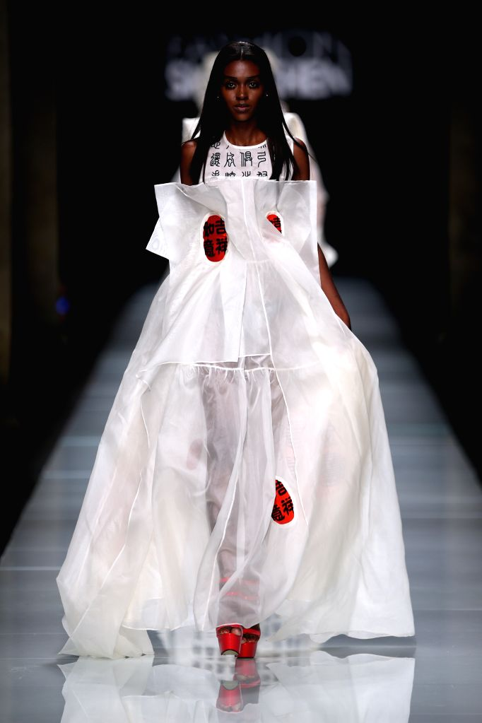 MILAN, Sept. 27, 2016 - A model presents a creation at the Xie Haiping fashion show, part of the Fashion Shenzhen event, during Milan Fashion Week Spring/Summer 2017 in Milan, Italy, Sept. 26, 2016.