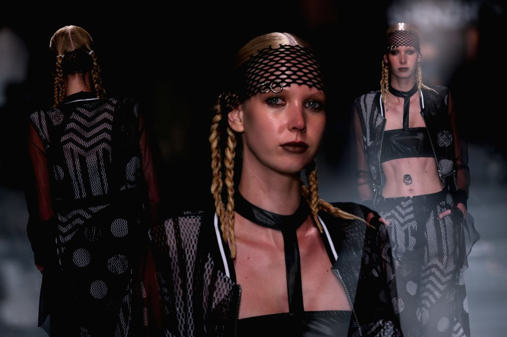 MILAN, Sept. 27, 2016 - The multiple explosure image shows a model presenting a creation at the La pargay fashion show, part of the Fashion Shenzhen event, during Milan Fashion Week Spring/Summer ...