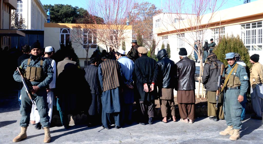 Militants Taliban stand handcuffed in Herat province, Afghanistan, Jan. 16, 2016. Afghan police personnel captured 9 militants Taliban during an operation in Herat on ...