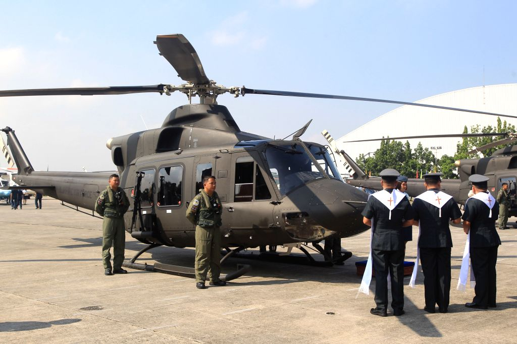 Military chaplains bless a newly-acquired Bell-412EP helicopter during a turnover ceremony at Villamor Air Base in Pasay City, the Philippines, Aug. 17, 2015. ...