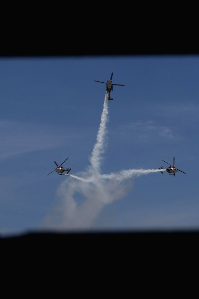 Military helicopters during an airshow at DefExpo 2018, in Chennai on April 13, 2018.